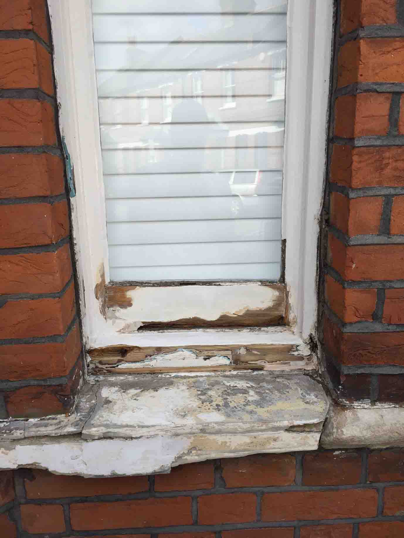 rotted and unpainted windowframe